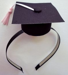 Make your own graduation hat using a headband and black cardstock.