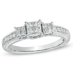 I've tagged a product on Zales: 1/2 CT. T.W. Enhanced Blue and White Princess-Cut Quad Diamond Three Stone Ring in 10K White Gold