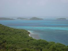 Great view over Mayreau's east reef to the group of islands that make of the Tobago Cay's Marine Park