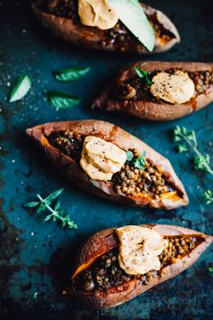 Get the recipe for this easy, delicious meat-free classic! These Vegan Lentil Sloppy Joe Stuffed Sweet Potatoes are savory, meaty and gluten free!
