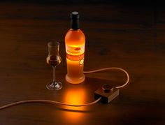 Djinn is an exclusive accessory for living and lounging areas. In combination with a filled bottle of liqueur or wine, djinn creates mood lighting. The liquid in the bottle acts as a colouring light filter. The curves of the bottle act to refract the glow from the light source.
