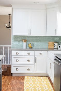 Kitchen Reveal - love this kitchen! Everything this blogger did, from new white shaker style cabinets to Quartz countertops that look like concrete and the gorgeous mint backsplash tiles. Stunning!