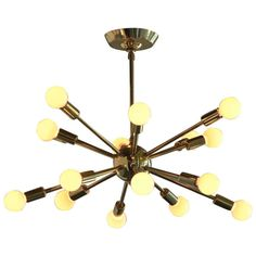 Mid-Century Modern Brass Sputnik Chandelier | From a unique collection of antique and modern chandeliers and pendants  at https://www.1stdibs.com/furniture/lighting/chandeliers-pendant-lights/