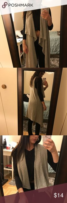 H&M long sleeveless sweater. Soft knit sleeveless sweater. Worn maybe once or twice. Downsizing closet so selling! NWOT H&M Sweaters Cardigans