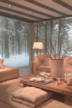 An incredible warm, cozy Modern Chalet style space surrounded by the beauty of a cold winter. That is a modern, chalet table if I have ever seen one!