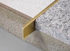 Natural brass joint for joining two floors e.g tile-terrazzo-wood-marble floors laid with mortar or adhesive. Natural brass joint for joining two floors e.g tile-terrazzo-wood-marble floors laid with mortar or adhesive. Terrazzo Flooring, Concrete Floors, Kitchen Flooring, Marble Floor Kitchen, Floor Edging, Floor Trim, Interior Design Atlanta, Office Interior Design, Marble Wood