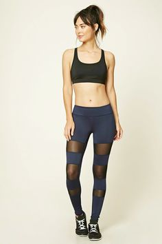 A pair of stretch-knit leggings featuring a striped mesh-paneled front, moisture management, and a hidden key pocket.