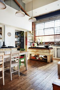 Natural light fills the industrial-style kitchen.