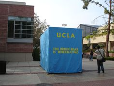 """UCLA Traditions - During the week before the big football game against USC, the bear is protected in heavy tarp with a sign reading, """"The Bruin Bear is hibernating."""""""
