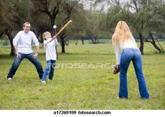 Family playing baseball View Large Photo Image