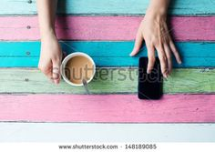 hand holding coffee cup and using smart phone - stock photo What do you think Michelle