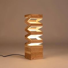 Warm, cozy, stylish, contemporary, modern. Just a few words that come to mind when seeing this lamp. Hand-crafted French quality. Original and unique design, made from recycled oak wood. Specially made for you, finish and size can vary slightly between orders. This lamp goes