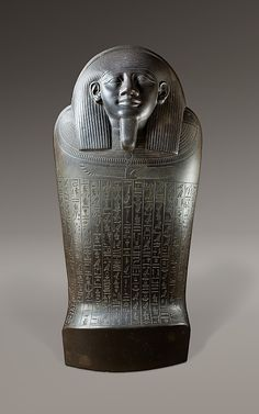 """Sarcophagus of Harkhebit~a """"Royal Seal Bearer, Chief Priest of the Shrines of Upper and Lower Egypt. His tomb was 60 ft. deep sunk into the desert and solid limestone bedrock. In a huge plain chamber at the bottom of the shaft, a rectangular rock core was left standing and hollowed out to house the sarcophagus. It contained the remains of a badly decomposed gilded cedar coffin, and a mummy that wore a mask of gilded silver, gold finger and toe stalls, and numerous small amulets. 664-525 B.C."""