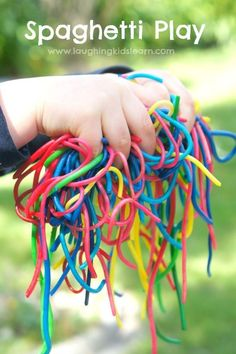 Playing with rainbow coloured spaghetti is a wonderful sensory activity for children of all ages, including babies - Laughing Kids Learn Infant Activities, Learning Activities, Kids Learning, Activities For Kids, Rainbow Activities, Baby Room Activities, Indoor Activities, Teaching Ideas, Baby Sensory Play