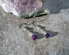 Gorgeous Amethyst Earrings to die for - featuring top grade Amethyst 6mm rounds and sterling silver components. ON SALE. Handcrafted with love, by yours truly. :) Give yourself the gift of a calming gemstone that is used by crystal healers to treat insomnia, migraines and anxiety.