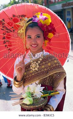 Portrait young woman in traditional Thai costume at traditional festival Chiang Mai Flower Festival Chiang Mai Chiang Mai Stock Photo