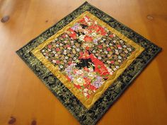 Quilted Table Topper Handmade Floral by PatchworkMountain on Etsy, $24.00