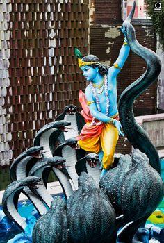 Lord Krishna fighting with Kaaliya Naag