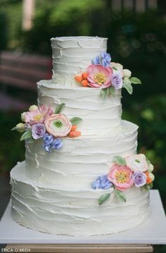 White Wedding Cake with Buttercream Icing with  Sugar Flowers. Very Elegant - Learn  more at www.thebohemianwedding,com/ - Wendy Schultz - Wedding Cake Ideas.