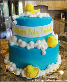 Connie Babbert's blog; marbled yellow/chocolate cake with buttercream frosting.  The ducks are made out of Fondant!