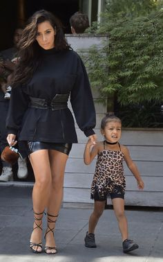 In a corset styled over a sweatshirt with North West