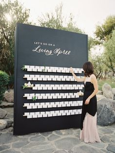 Black and white modern wedding escort card display: http://www.stylemepretty.com/2016/07/18/whats-black-white-and-modern-chic-this-palm-springs-wedding/ Photography: Abby Jiu - http://www.abbyjiu.com/contact/