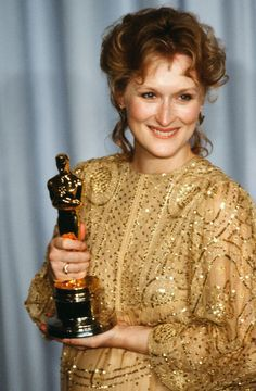 Meryl Streep When: 1983 For: Sophie's Choice Comments: This is glitzy but also like a caftan, which is chill. Like an Oscar on vacation in Maui. Gary Oldman, Clint Eastwood, Nicole Kidman, Oscars, 90s Stars, Movie Stars, Sophie's Choice, Oscar Dresses, Robert De Niro