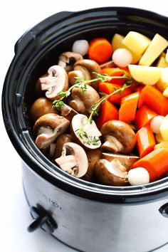 This Portobello Pot Roast recipe is easy to make in the slow cooker or pressure cooker (Instant Pot) it's full of tender potatoes mushrooms carrots onions garlic and a savory gravy it's naturally gluten-free vegetarian and vegan and it's TOTALLY d Pot Roast Recipes, Veggie Recipes, Whole Food Recipes, Healthy Recipes, Vegan Crockpot Recipes, Vegetarian Recipes Instant Pot, Vegetarian Meals, Fast Recipes, Dip Recipes