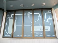 The beer brewing process is described on the outside of the Odyssey builing during the 2014 Epcot International Food & Wine Festival. Craft Beer is inside the building this year instead of being at an outside kiosk. Window 2.