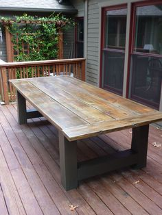 Outdoor Farmhouse Table.  Aged and Distressed Pine top sealed with Marine Varnish.  RagtimeWoodwork.com