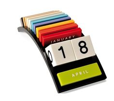 Rainbow perpetual calendar made of Corian by Niels Kjedsen