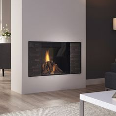 Dru Excellence 60: A large gas fire with an authentic log bed, available with interior finishes in smooth black, natural stone or grey slate.   #kernowfires #wadebridge #redruth #cornwall #dru #gas #fire #excellence #log #bed #interior #finishes #stone #natural #slate #modern #contemporary