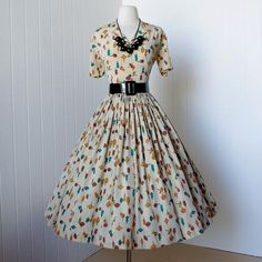 Vintage Fashion: beautiful multi-colored white dress with red, yellow and blue and a black belt. Would totally wear.