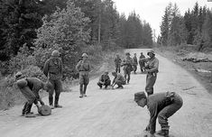 Finnish army-engineers lay mines in a country road in the Ihantala, (now Vyborg) district of Leningrad region.