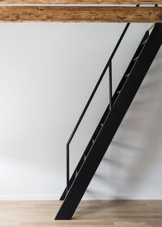 Steel ladder leads to mezzanine office in Jersey City remodel by Mowery Marsh Architects. Loft Stairs, Basement Stairs, House Stairs, Basement Ideas, Open Basement, Basement Guest Rooms, Basement Bathroom, Balustrades, Stair Storage