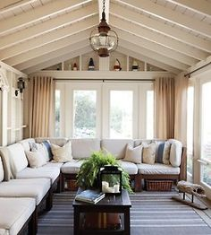 Love the peaked roof in this #sunroom.  Great neutral colors too.