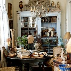 Mary Randolph Carter, Never Stop To Think Do I Have a Place for This...love the blue cabinet, the table and the chandelier.  too much stuff around for me but for some reason, I like this
