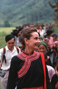 1990: UNICEF Goodwill Ambassador, Audrey Hepburn, walks down a village pathway with Vietnamese 'Dao' hill tribe children. She is wearing an ethnic minority traditional costume given to her by the women of this village in northern Vietnam.