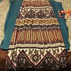 """Multicolor Maxi Skirt Colorful pleated light and flowy maxi. Elastic waist measures 12.5"""" flat and length measures 36"""" from waistband. 100% rayon. NWOT. Never worn. Colors include navy blue, red, cream, gold and black. Crimson & Clover Skirts Maxi"""
