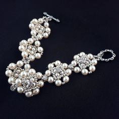 Ivory pearl bracelet Wedding bracelet from glass pearls and crystals Beadwoven bridal bracelet in Victorian style Evening beaded jewelry by GerdanEtnoStyle on Etsy Cute Jewelry, Pearl Jewelry, Beaded Jewelry, Women Jewelry, Beaded Bracelets, Unique Jewelry, Ladies Jewelry, Silver Bracelets, Jewelry Crafts
