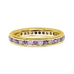 A pink sapphire and diamond full eternity ring, alternately set with round brilliant cut diamonds, combined weight 0.40-0.75 ct*, and pink sapphires combined weight 0.45-0.80 ct*, mounted in an 18ct yellow gold channel setting, bandwidth 3.5mm. * Ring size dependant