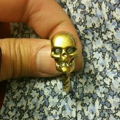 Authentic Alexander McQueen brass skull ring SZ 6 Authentic Alexander McQueen infamous brass ring with the skull head which eyes and teeth are made of Swarovski crystals. This is a solid ring and pretty heavy so you can feel the quality. I'm a size 7 so since it was too small & as you can see fit sooooo snug on my sausage finger, it's in beautiful condition. The ring in the pictures speaks for itself. PRICE IS FIRM.. NO TRADES. . So please don't ask. Alexander McQueen Jewelry Rings