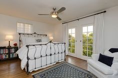 875 Bellefontaine Place -- an iron bed frame and french doors deliver a classic look.