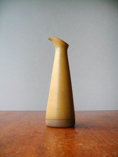 Vintage mid century Martz Marshall Studios cruet or bud vase M77 with a matte ochre / mustard glaze. Circa 1960s  Source: etsy.com
