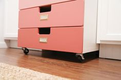 Ikea STUVA chest of drawers: painted in ombre shades of peach, turned into a rolling cart with Home Depot casters, Martha Stewart bookplates added to label the contents
