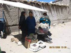 Dona Maximiliana and her daughter selling a few products, including quinoa flour, on the local market