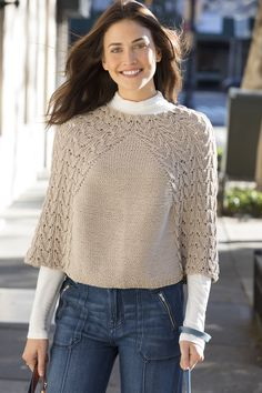 Waverly Place Poncho in PATTI sports two large knit lace panels. The panels can be worn centered front and back, or at the shoulders.