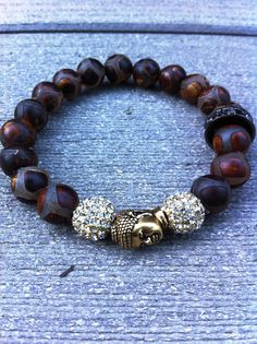 Beautifully patterned Tibetan beads with an antique gold Buddha bead surrounded by pave crystals.