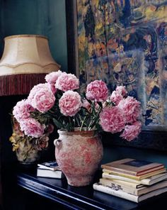 Peonies.  Another picture of my fave pink peonies-I love how a simple bouquet of flowers brings life into a room