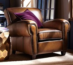 Who says that a leather club chair is masculine? When paired with rustic woods and global inspired textiles, you create a look that is chic and distinctive.